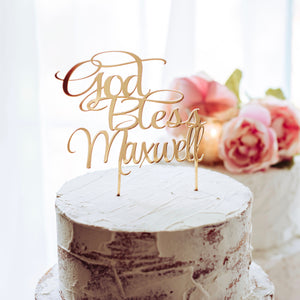 Gold acrylic cake topper on white cake for Baptism decorations