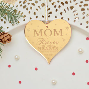 Gold heart memorial ornament for mom on a cake plate