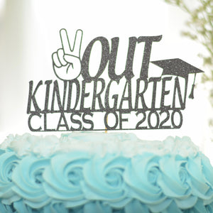 Kindergarten grad cake topper class of 2020 on a blue cake