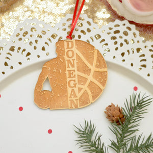 Basketball Christmas tree ornament sitting on a cake plate