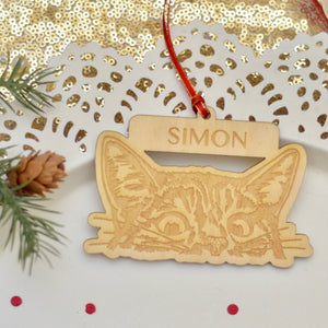 Personalized cat ornament on a white cake plate