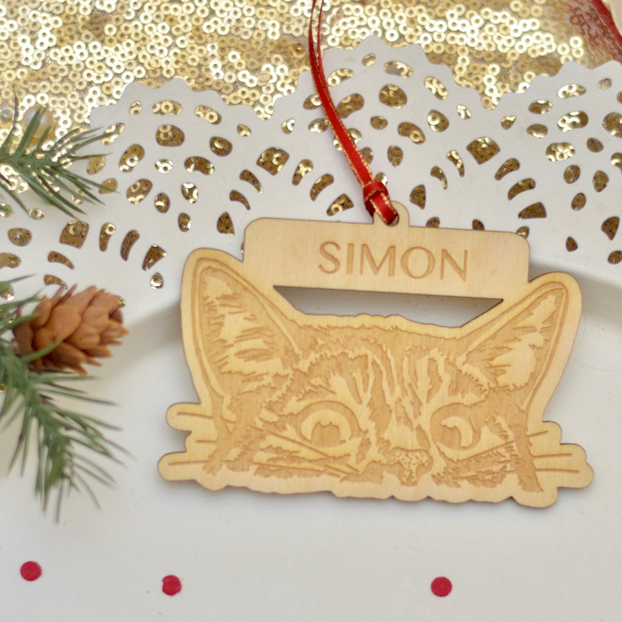 Cat peeking Christmas tree ornament