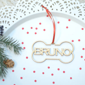 Bruno Christmas Tree ornament on a cake plate with red confetti