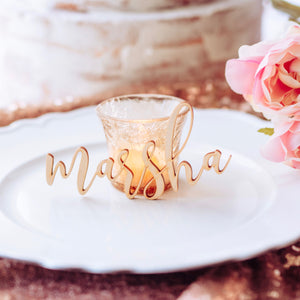 rose gold wedding with wooden place card leaning on a candle