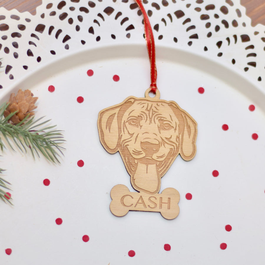 Rhodesian Ridgeback Wooden Christmas ornament on a cake plate with confetti