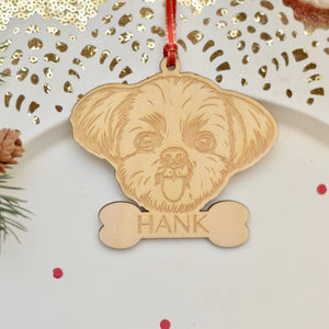 Personalized shih tzu ornament on a cake plate with red confetti