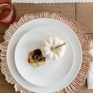 Thanksgiving place setting with white pumpkin and gold place setting