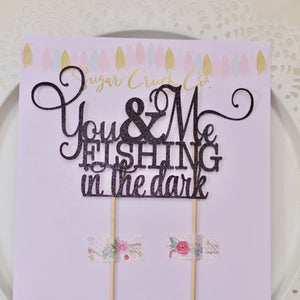 you & me fishing in the dark black cake topper displayed on Sugar Crush Co backing