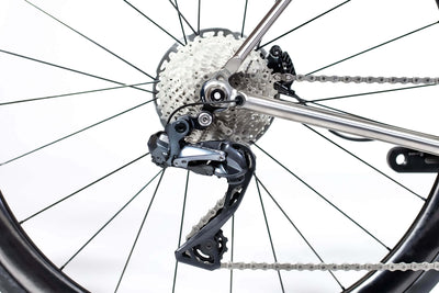 Close up image of rear brake and derailleur