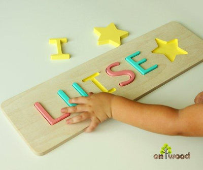 1st Christmas Gift. Personalized Baby Name Puzzle. - BOSTON CREATIVE COMPANY