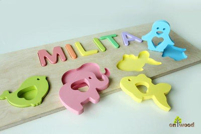 Personalized Baby Girl Gift for Christmas. Wooden Name Puzzle with Bird, Elephant, Fish and Penguin shapes. - BOSTON CREATIVE COMPANY