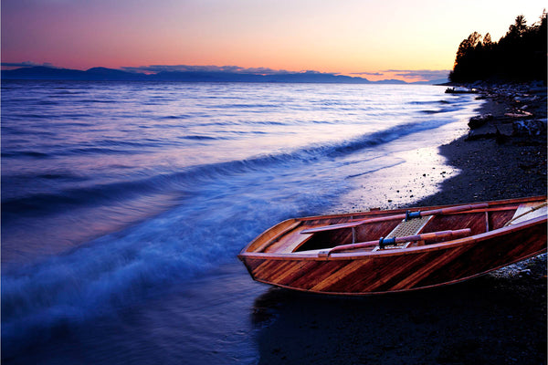 Wooden boat on beach with sunset - orange, blue and pink sky - Nautical photography by Shel Neufeldn