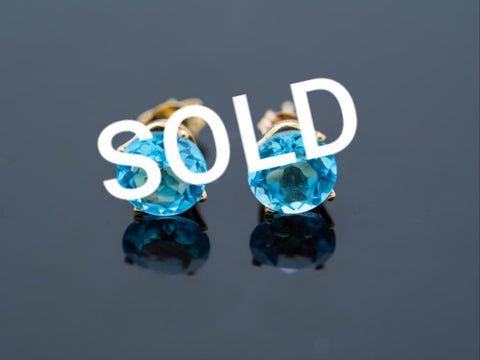 18 Karat Blue Topaz Earrings