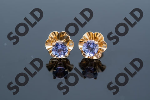 Beautiful Tanzanite 1.0 tcw earrings set in 14 karat yellow gold