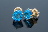11.0 tcw Blue Topaz earrings set in 14 karat gold