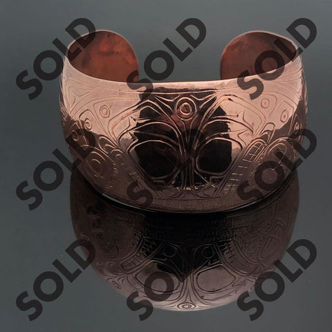 Hand carved and signed by the artist Solomon Seaward  this Copper bracelet depicts 2 breaching Killer Whales