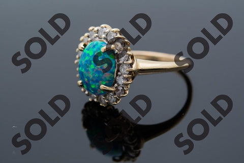 Beautiful Black Opal Dinner Ring with Approximately .80 ct natuarl round brilliant diamonds
