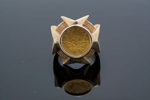 10 Karat yellow Gold ring weighing 44.63 grams including 1/10 ounce Canadian Maple Leaf