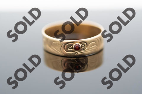 Eagle Ring hand carved in 14 karat yellow gold with a small round brown stone highlighting the eye of the design