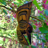 Native red-cedar carving of a hummingbird.