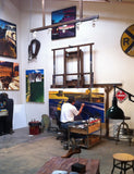 Artist Z.Z. Wei painting in his Washington art studio.