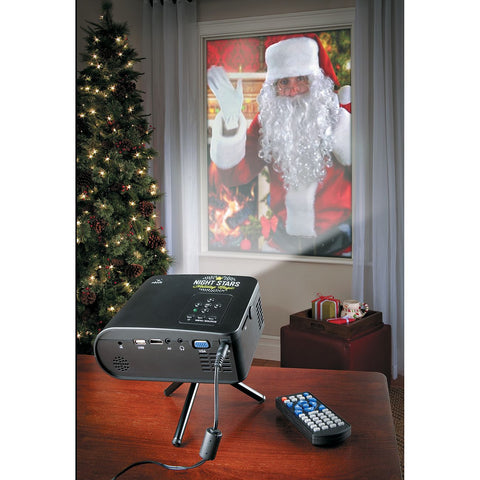 projector lighting with santa claus in window