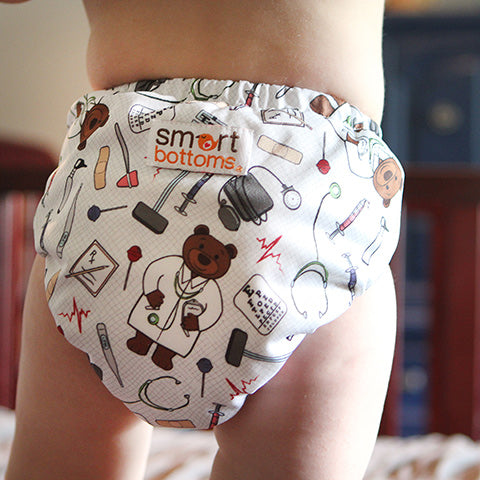 doctor print cloth diaper cover on a baby