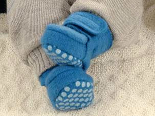 merino wool baby booties Disana on a baby