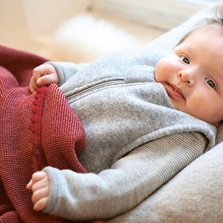 disana wool clothes on a baby
