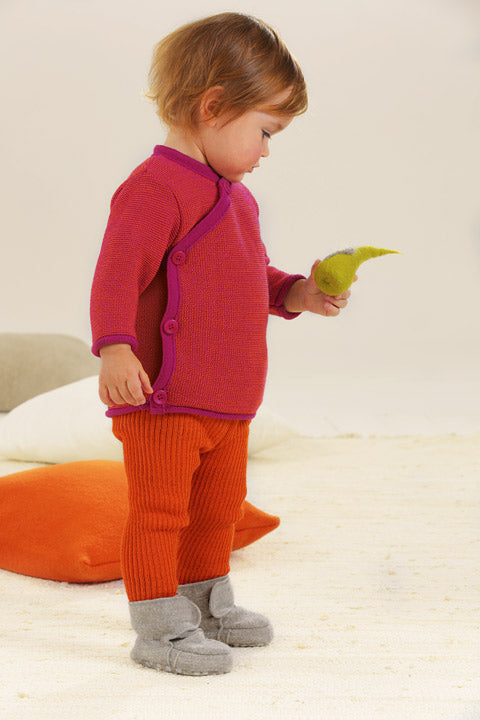 disana orange leggings on a baby