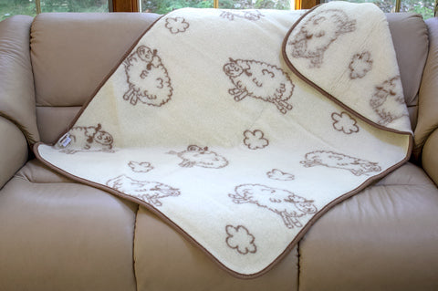 Flokati summer lambs wool baby blanket on a couch