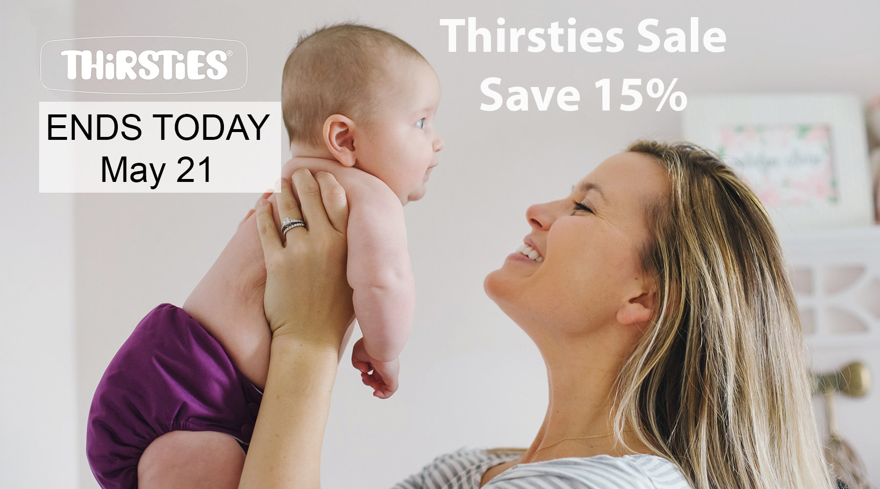 mom holding baby, thirsties sale ends today