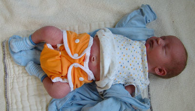 newborn baby in size one Thirsties Duo mango snap diaper cover