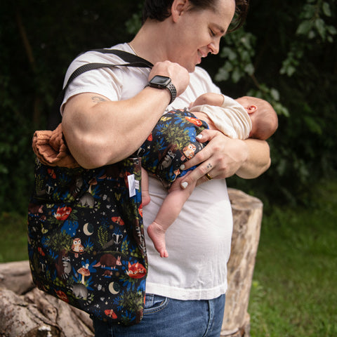 Thirsties simple tote reusable bad and dad holding newborn baby