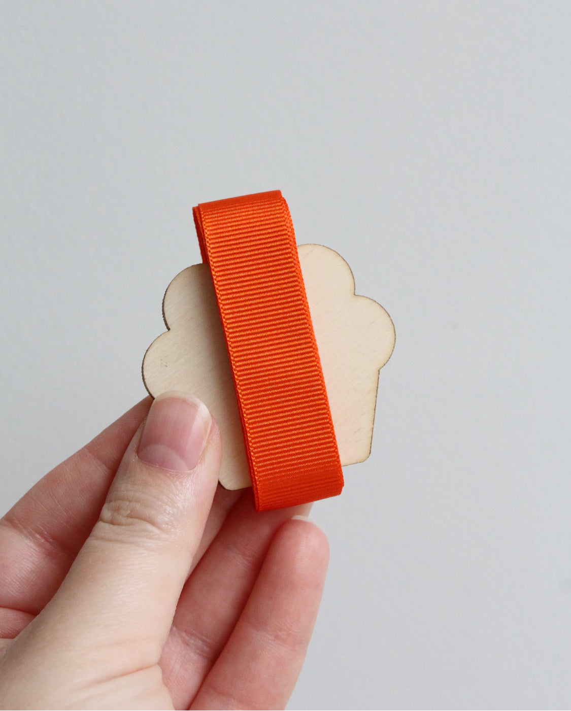 Orange grosgrain ribbon on wooden cutout cupcake