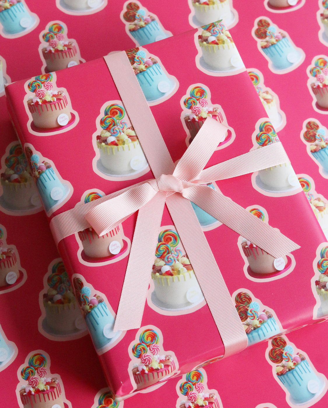 Sweetie Cake Pink Wrapping Paper tied with Ribbon At angle