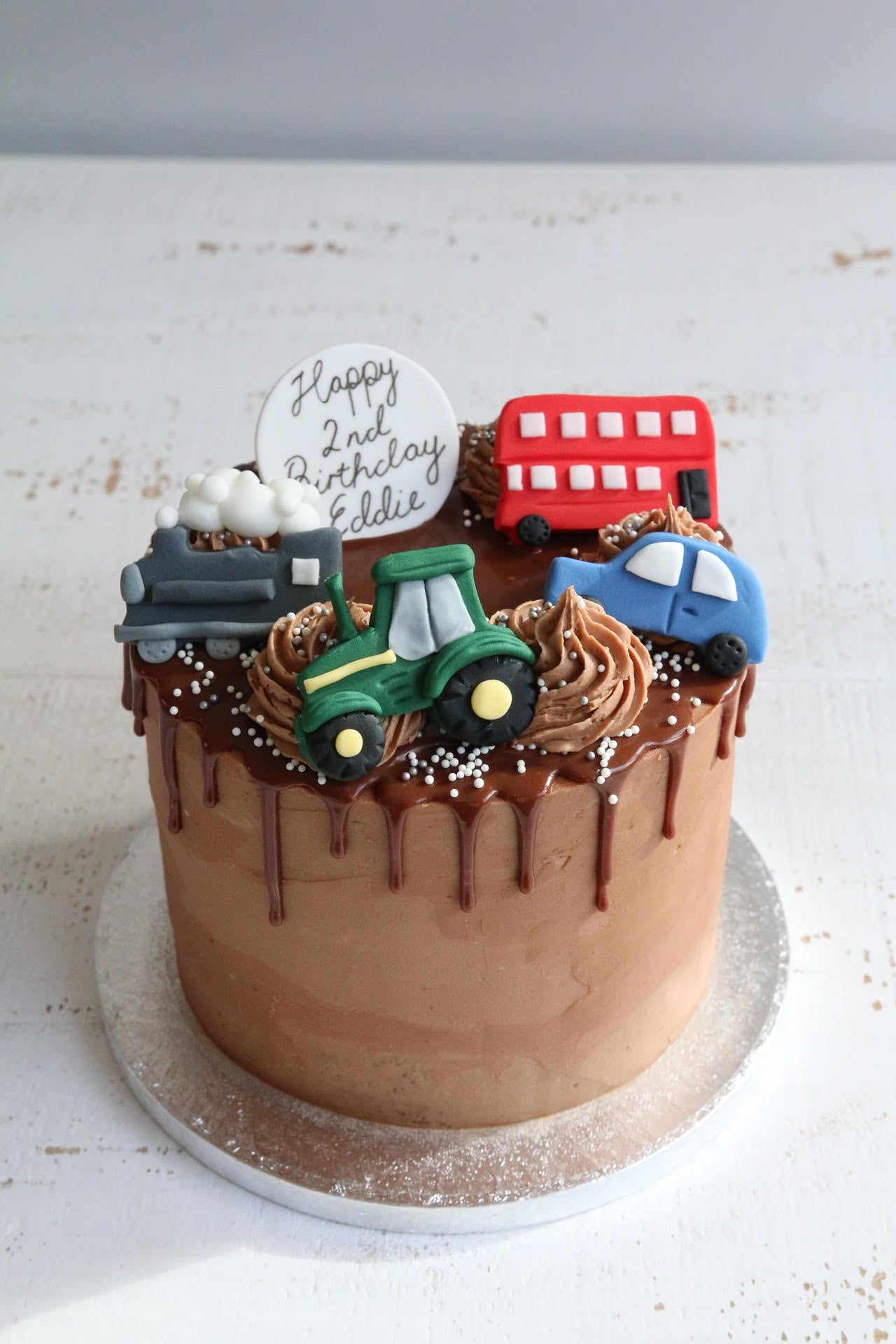 Vehicle Drip Cake with Tractor, Bus, Train and Car
