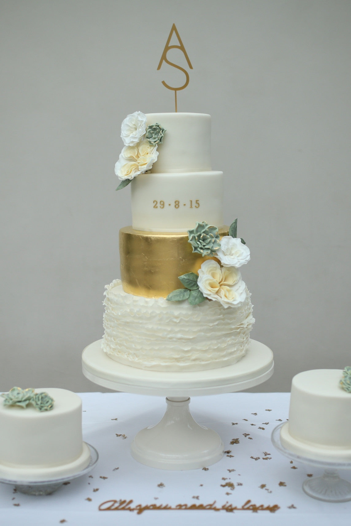 Wedding Cake with Succulents, Gold Leaf and Ruffles