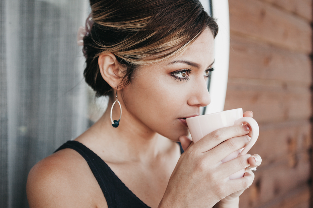 healthy woman drinking green tea