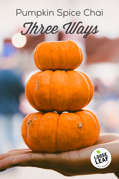 pumpkin spice chai image with three pumpkins
