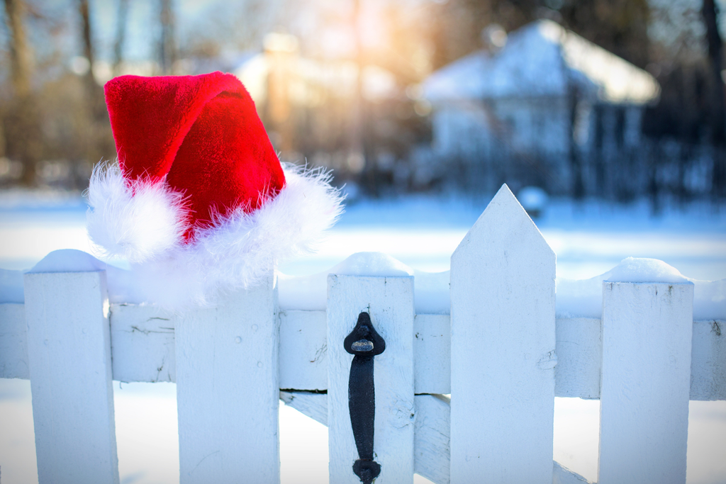 santa hat on a white fence