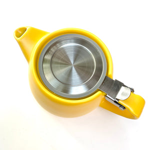 yellow ceramic teapot with infuser