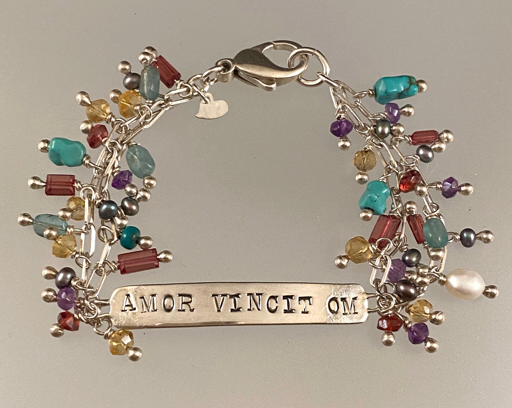 'Love Conquers All' Sterling and Gemstone Charm ID Bracelet