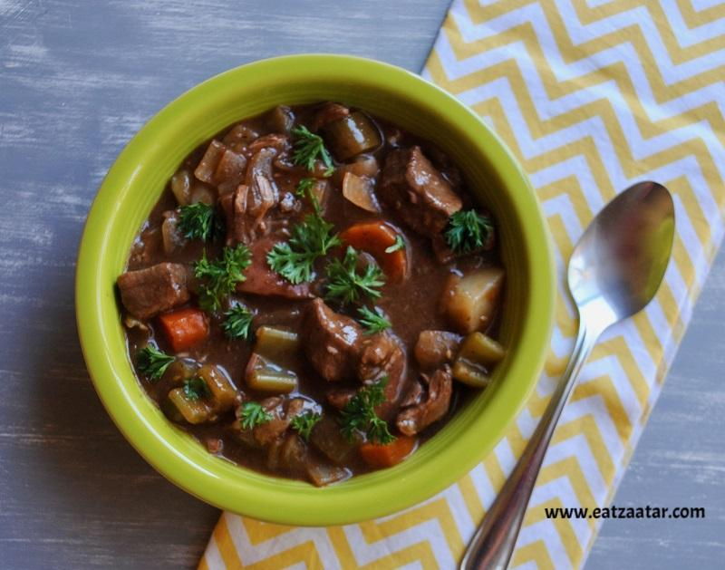 Slow Cooker Zaatar Beef Stew served in a bowl and garnished with fresh parsley