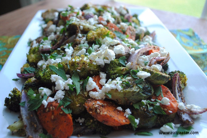 zaatar roasted vegetables with goat cheese ready to serve close up