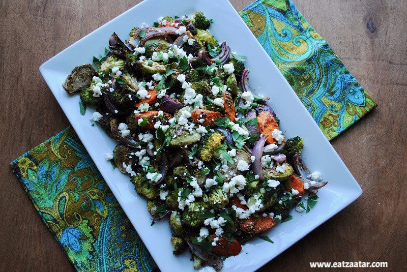 recipe step ready to serve -  zaatar roasted vegetables with goat cheese