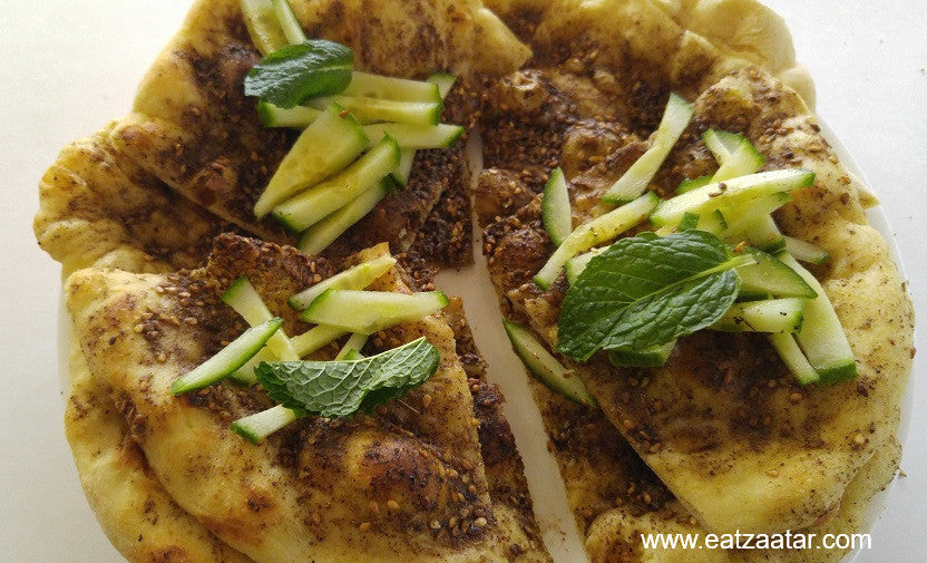 man'esh zaatar bread ready to serve with sliced cucumber and fresh mint toppings