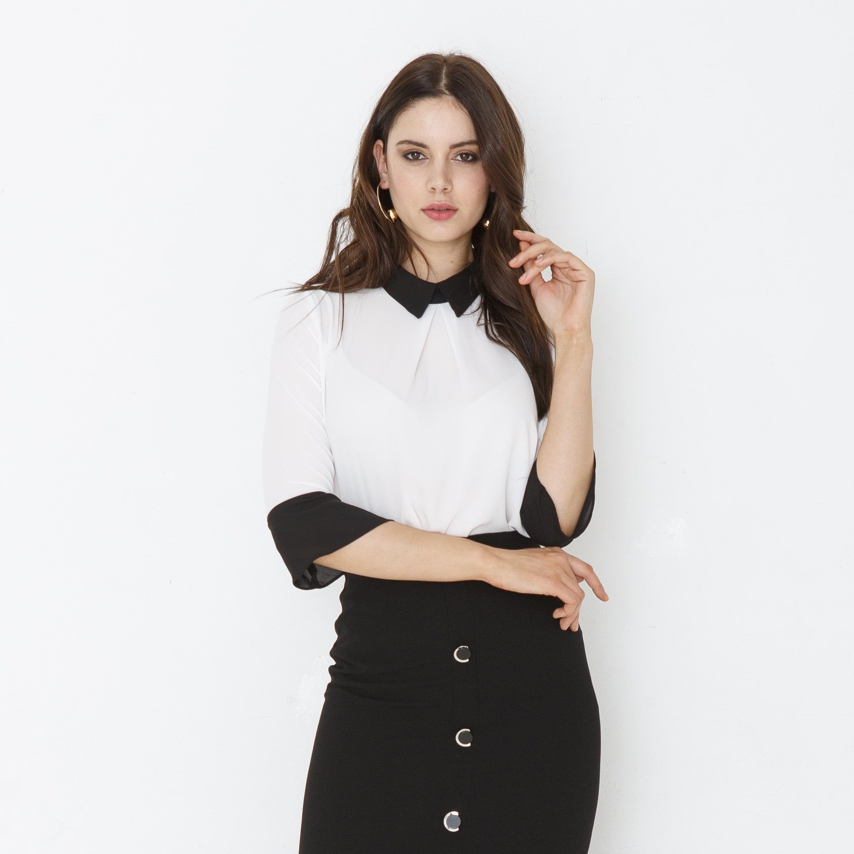 White top with black collar
