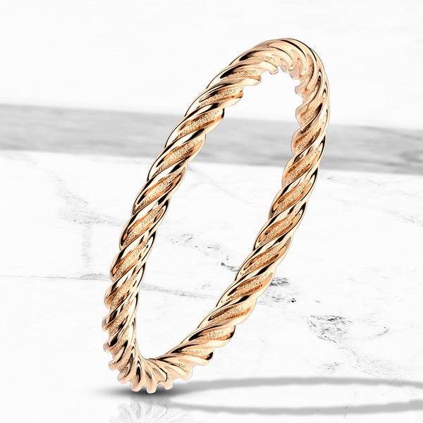 Rose gold band twirl design - Unleashed Jewelry