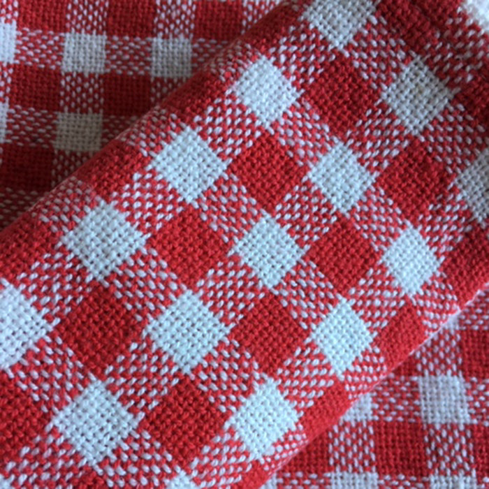 Woven table napkins with hand finished hems, by Norfolk based weaver Mavy Burden